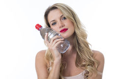 Young Healthy Woman Holding a Bottle of Water To Face. Attractive Young Healthy Woman Holding a Bottle of Water To Face Stock Image
