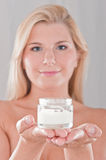 Young healthy woman holding creme box Royalty Free Stock Photo