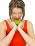 Young Healthy Woman Holding a Fresh Ripe Green Apple Stock Photos