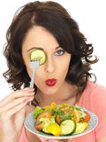 Young Healthy Woman Holding a Freshly Mixed Salad Stock Image