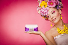 Young healthy woman holding gift box on her palm Stock Photography