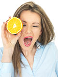 Young Healthy Woman Holding an Orange Cheeky Stock Images
