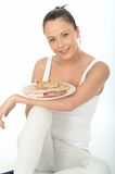 Young Healthy Woman Holding Plate of Cold Meats Royalty Free Stock Image