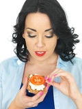 Young Healthy Woman Holding a Wholegrain Cracker with Cottage Cheese and Fresh Ripe Tomato Stock Photo