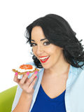 Young Healthy Woman Holding a Wholegrain Cracker with Cottage Cheese and Fresh Ripe Tomato Royalty Free Stock Photos