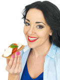 Young Healthy Woman Holding a Wholegrain Cracker with Mozzarella Cheese and Fresh Ripe Tomato Stock Photography