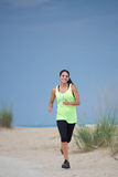 Young Healthy Woman Jogging by Beach Royalty Free Stock Image