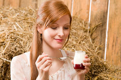 Young healthy woman with natural yogurt country Royalty Free Stock Photo