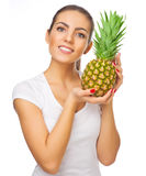 Young healthy woman with pineapple Royalty Free Stock Photo