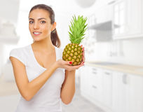 Young healthy woman with pineapple Stock Photography