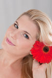 Young healthy woman with red flower Royalty Free Stock Photo