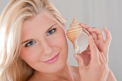 Young healthy woman with sea shell Royalty Free Stock Photos