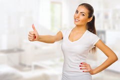 Young healthy woman shows ok gesture Stock Photos