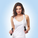 A young and healthy woman with a skipping rope Stock Images
