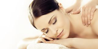 Portrait of a girl in spa. Massaging therapy procedure. Skin care and face lifting concept. royalty free stock photos