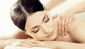 Portrait of a woman in spa. Massage healing procedure. Health care, skin lifting and medical concept. royalty free stock photography