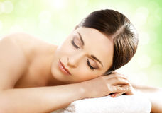 Young and healthy woman in spa salon  on white Royalty Free Stock Photos