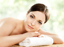 Young and healthy woman in spa salon  on white Royalty Free Stock Photography