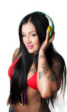 Young heavily tattooed woman Listening to DJ Style Head Royalty Free Stock Photography