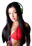 Young heavily tattooed woman Listening to Headphones Royalty Free Stock Photo