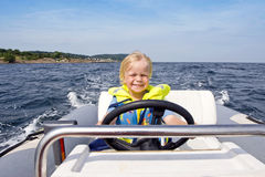 Young helmsman Stock Photo