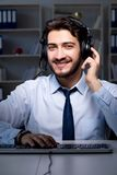 Young help desk operator at night Royalty Free Stock Photography