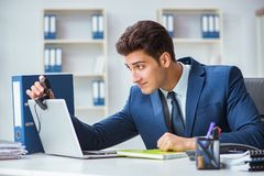 The young help desk operator working in office Stock Image