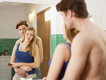 Young heterosexual couple in bathroom Stock Images