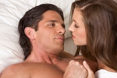 Young heterosexual couple in bed Royalty Free Stock Image