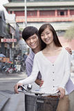 Young Heterosexual Couple on a Bicycle in Beijing Stock Images