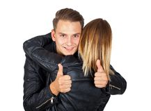 Embracing couple thumbs up Stock Image