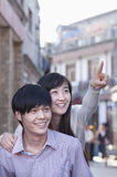 Young Heterosexual Couple Pointing Outdoors in Beijing Royalty Free Stock Photography