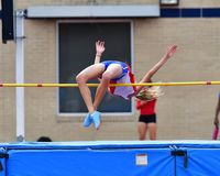 Graceful Track and Field High Jumpers clearing the bar royalty free stock photography