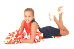 Young high school cheerleader laying down with pom poms Stock Images