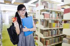 Young high school student in library Stock Photos