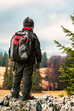 Young hiker with backpack on peak Royalty Free Stock Photo