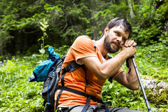 Young hiker with backpack resting Stock Images