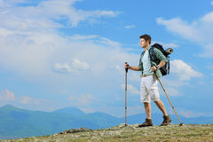 A young hiker with backpacker hiking in the mountain Royalty Free Stock Photos