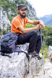 Young hiker with beard resting on the mountain Royalty Free Stock Photo