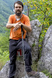 Young hiker with beard resting on the mountain Royalty Free Stock Photography
