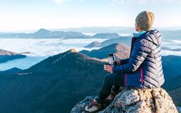 Free Young Hiker Female Sitting On The Mountain Summit Cliff And Enjoying Mountains Valley Covered With Clouds View. Successful Summit Royalty Free Stock Photos - 216084148