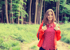 Young hiker in forest smiling enjoying nature. Leisure activity concept. stock photos