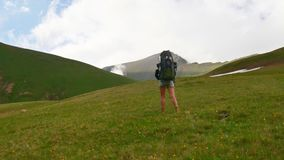 Young Hiker girl walking up with Hiking backpack in beautiful mountain nature landscape stock video footage
