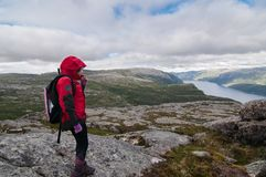 Young hiker having rest over background of the fjord Stock Photo