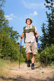 Young hiker hiking in the mountain Stock Photo