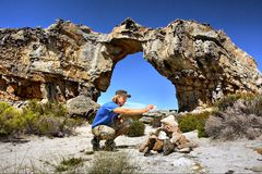 Young hiker makes a rock heap Stock Photography