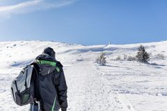 Young Hiker Man in the  Winter Mountain. Young man in back in the  winter mountain , adventure concept Royalty Free Stock Photos