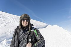 Young Hiker Man in the  Winter Mountain. Happy man in the winter mountain , adventure concept Royalty Free Stock Image