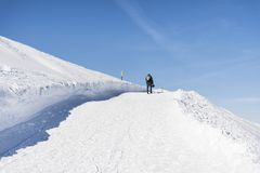 Young Hiker Man in the  Winter Mountain. Young man  standing near  winter mountain valley - adventure concept Royalty Free Stock Photos