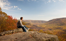 Young hiker relaxing on rock Stock Photos